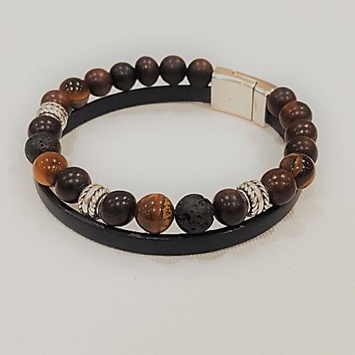 Le bracelet est porté avec de l'œil de tigre jaune, de la pierre de lave et du bois d'Ebène tigre